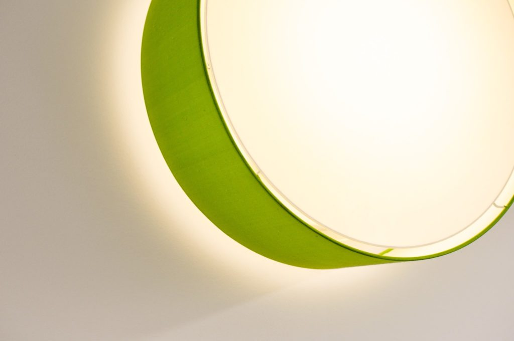 Green wall or ceiling mounted lamp filumen CYLS Eye with light gap between diffusor and fabric shade.