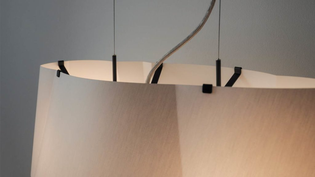 Through the translucent fabric shade the two lights paint a pleasant gradient across the BENT cloud pendant lamp.